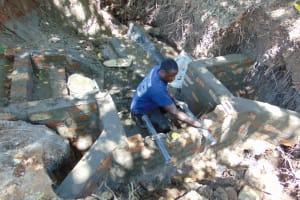 The Water Project: Kimang'eti Community, Kimang'eti Spring -  Pipe Setting