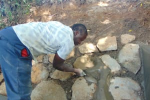 The Water Project: Kimang'eti Community, Kimang'eti Spring -  Stone Pitching Plaster