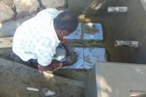 The Water Project: Kimang'eti Community, Kimang'eti Spring -  Tile Setting