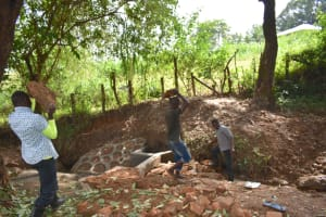 The Water Project: Kimang'eti Community, Kimang'eti Spring -  Delivering Large Stones For Backfilling