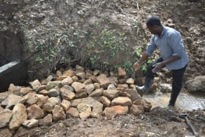 The Water Project: Kimang'eti Community, Kimang'eti Spring -  Stone Backfilling
