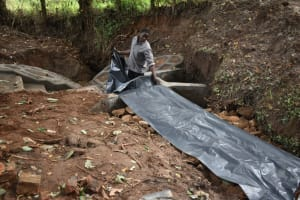 The Water Project: Kimang'eti Community, Kimang'eti Spring -  Fitting The Tarp