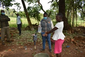 The Water Project: Kimang'eti Community, Kimang'eti Spring -  Community Member Tries Out The Ten Handwashing Steps