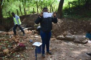 The Water Project: Kimang'eti Community, Kimang'eti Spring -  Mask Making Demonstration