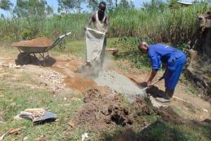 The Water Project: Mahira Community, Mukalama Spring -  Mixing Cement