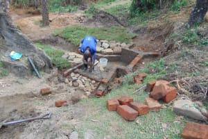 The Water Project: Mahira Community, Mukalama Spring -  Wall Construction