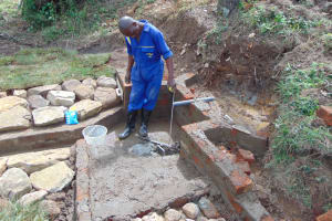 The Water Project: Mahira Community, Mukalama Spring -  Pipe Setting
