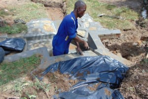 The Water Project: Mahira Community, Mukalama Spring -  Fitting The Tarp Over The Stones