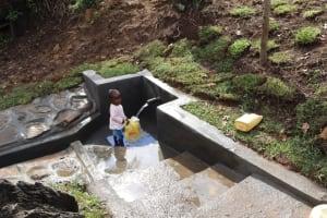 The Water Project: Mahira Community, Mukalama Spring -  Child At The Spring