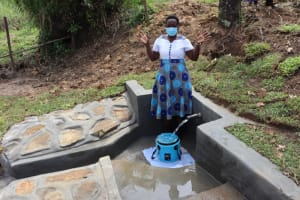 The Water Project: Mahira Community, Mukalama Spring -  Field Officer Betty Celebrates The Completed Spring