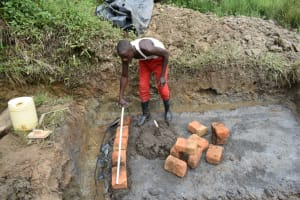 The Water Project: Mukhungula Community, Mulongo Spring -  Brick Setting