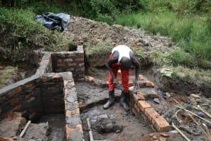 The Water Project: Mukhungula Community, Mulongo Spring -  Wall Construction