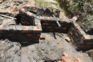 The Water Project: Mukhungula Community, Mulongo Spring -  Setting The Pipe