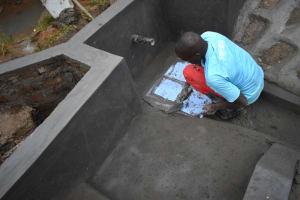 The Water Project: Mukhungula Community, Mulongo Spring -  Setting The Tiles