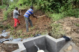 The Water Project: Mukhungula Community, Mulongo Spring -  Soil Backfilling