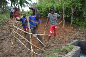 The Water Project: Mukhungula Community, Mulongo Spring -  Planting Grass
