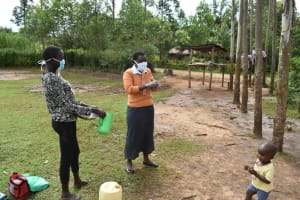 The Water Project: Mukhungula Community, Mulongo Spring -  Trainer Rose Shows Ten Steps Of Handwashing