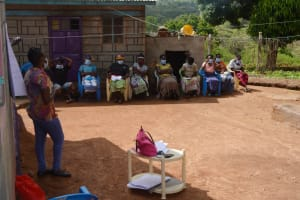 The Water Project: King'ethesyoni Community -  Participants Stay Cool In The Shade