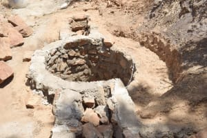 The Water Project: King'ethesyoni Community A -  Well Walls Building Up