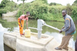 The Water Project: Yumbani Community A -  Sylvester Nzangu And Florence Munyau At The Water Point