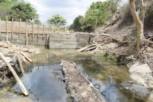 The Water Project: Yumbani Community -  Dam Walls In Progress