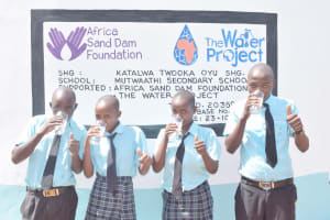 The Water Project: Mutwaathi Secondary School -  Drinking From The Rain Tank