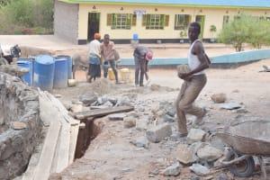 The Water Project: Mutwaathi Secondary School -  Hauling Rocks
