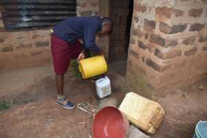 The Water Project: Givudemesi Primary School -  Transfering Water Into Smaller Container To Take To School
