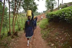 The Water Project: Kabinjari Primary School -  Ferrying Spring Water To School