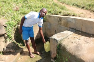 The Water Project: St. Benedict Emutetemo Primary School -  Clinton Fetches Water For School Use