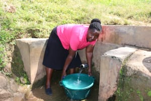 The Water Project: St. Benedict Emutetemo Primary School -  Madam Okello Fetches Water For School Use
