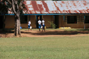 The Water Project: St. Benedict Emutetemo Primary School -  Students Carrying Water