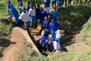 The Water Project: St. Benedict Emutetemo Primary School -  Students Collecting Water
