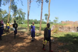 The Water Project: Emachina Primary School -  Students Carrying Water