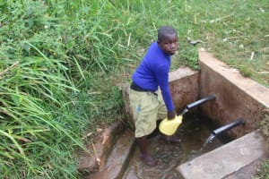 The Water Project: Mungabira Primary School -  Charles Fetching Water