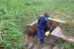 The Water Project: Mungabira Primary School -  Fetching Water