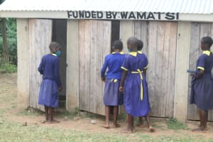 The Water Project: Mungabira Primary School -  Girls At Their Latrines