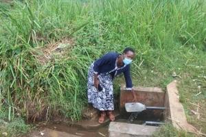 The Water Project: Mungabira Primary School -  Madam Judith Chebechuma Fetching Water