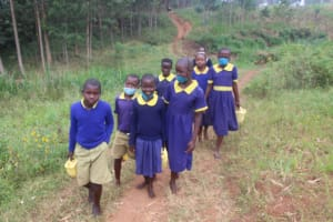 The Water Project: Mungabira Primary School -  Students Carrying Water