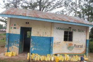 The Water Project: Mungabira Primary School -  Water Containers Outside The Kitchen