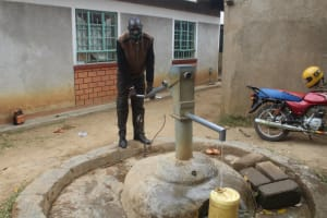 The Water Project: Petros Primary School -  Mr Kipyeko Fetching Water