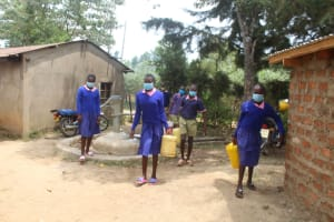 The Water Project: Petros Primary School -  Students Carrying Water