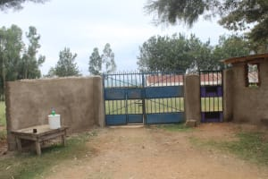 The Water Project: Petros Primary School -  School Gate With Handwashing Station And Soap