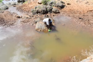 The Water Project: Yathui Community A -  Scooping Water At The Open Source