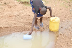 The Water Project: Kitile B Village Well -  Collecting Water