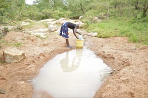The Water Project: Kitile B Village Well -  Filling Up At The Scoop Hole