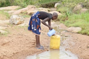 The Water Project: Kitile B Village Well -  Filling Up The Container