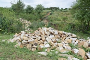 The Water Project: Kitile B Village Well -  Rocks Collected For Sand Dam