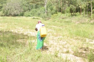 The Water Project: Ivumbu Community C -  Carrying Water Home
