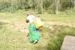 The Water Project: Ivumbu Community C -  Carrying Water